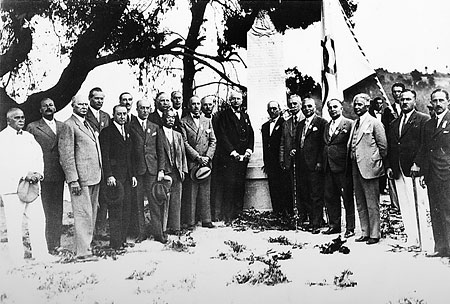 Commemorative photograph in front of the monument to commemorate the 40th anniversary of the restoration of the Olympics, following the end of the IOC Session at Olympia, Athens, on 23 June, 1934.